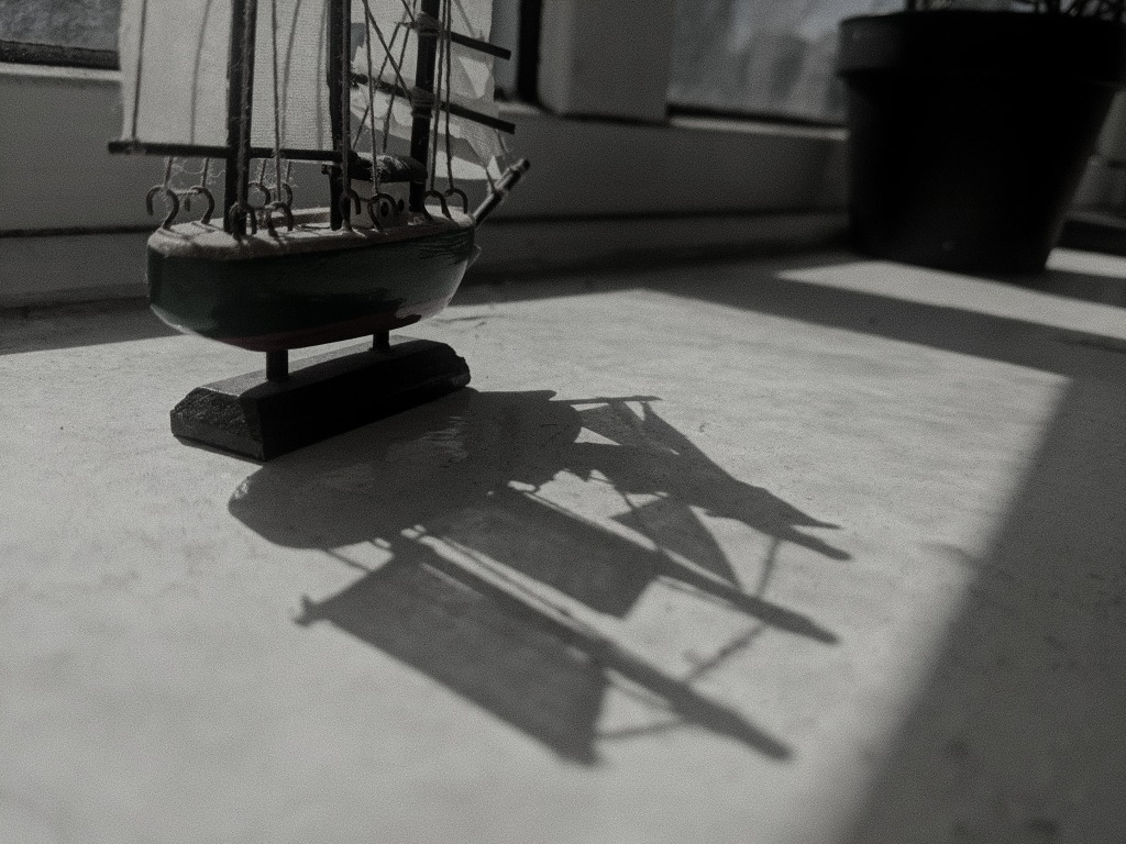 Shadow cast by model ship